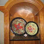 Hand-painted nested bowls can be displayed in shelves.