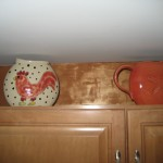 Giftware can decorate the space above your kitchen cabinets.