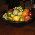 A large nested bowl full of fruit.