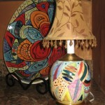 Close-up of a hand painted lamp.