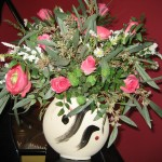 Flower arrangement in disc vase - $75